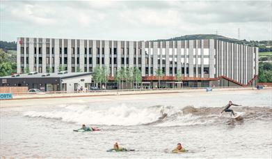 Exterior of Hilton Garden Inn hotel and view of surf lagoon