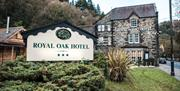 Image of front entrance and sign for Royal Oak Hotel