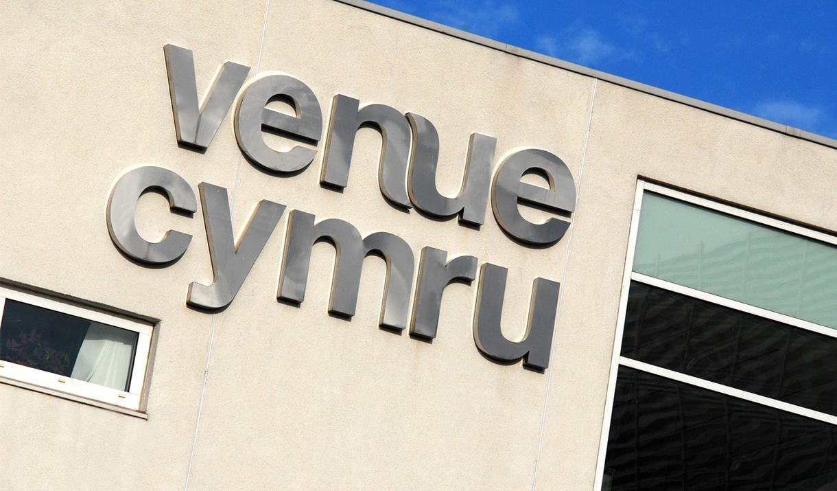 Image shows Venue Cymru logo on side of building