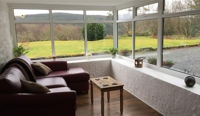 Image of conservatory area with views of the garden
