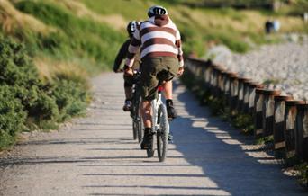 Cyclists riding on coastal path