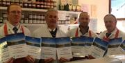 Four butchers inside R Evans Butchers shop