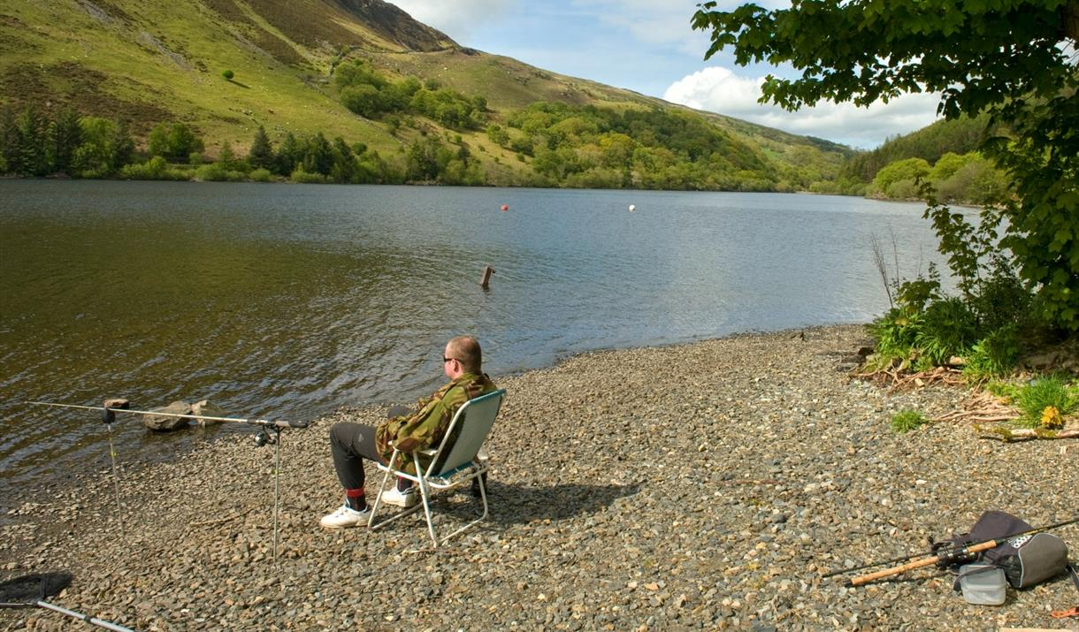 Man fishing on the shore of Llyn Brenig