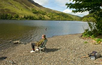Man fishing on the shore of Llyn Brenig
