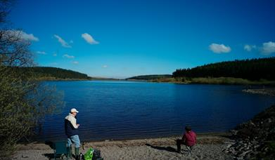 People fishing at the Alwen Reservoir