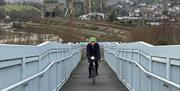 Image of man riding bike on Conwy bridge