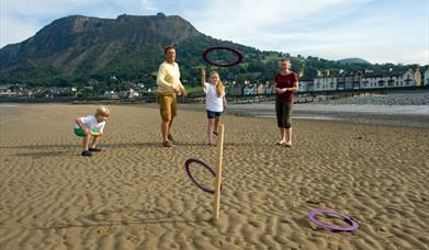 Family playing quoits on Llanfairfechan Beach
