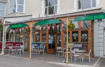 Outside of the Irish Bar with seating