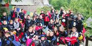Large group of children wearing wetsuits