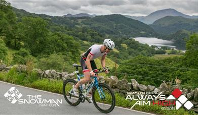 Image of cyclist on scenic route
