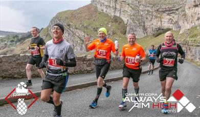 Image shows runners on Marine Drive, Llandudno