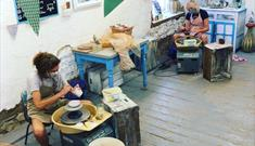 At the potters wheel - Eastnor Pottery