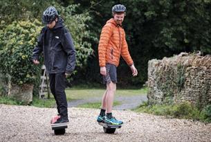 Men on one wheel boards