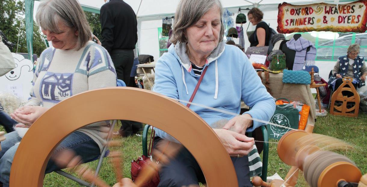 Women spinning.