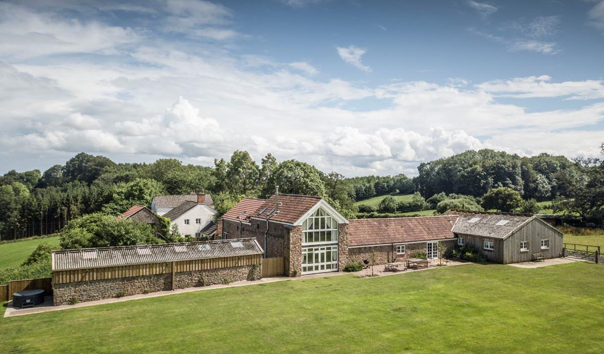 Lodge Barn - aerial view of the generous outdoor space, quiet rural location and spacious accommodation at Lodge Barn