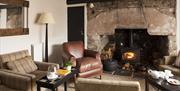 Lounge with wood burner at Tudor Farmhouse