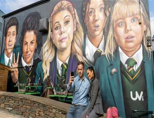Selfie in front of Derry Girls Mural
