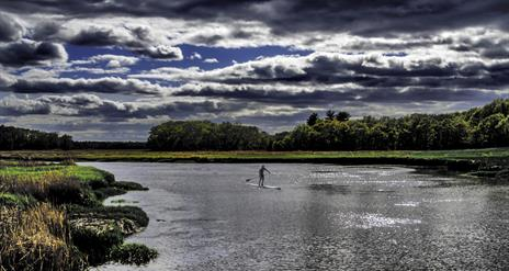 A man on a Stand Up Paddleboard with Wild Atlantic Travel Co.