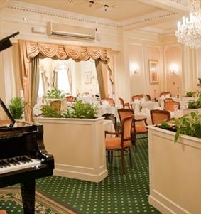 Dining room with piano