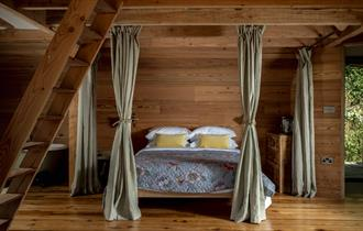Wolf Wood Treehouses Bed