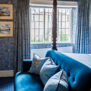 Double four-poster bedroom at The Acorn Inn, Dorset