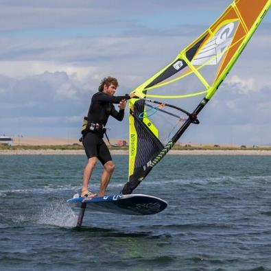 Man riding a windfoil board in Dorset