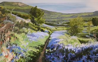 Oil painting on canvas of bluebells lining a path towards Golden Cap in west Dorset.
