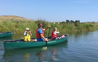 Enjoy a scenic paddle with West Bay Canoes - Visit Dorset