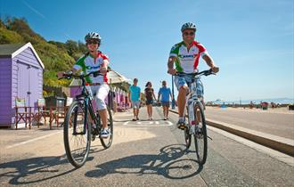 Two cyclists on the promenade between Hengistbury Head and Sandbanks, Dorset