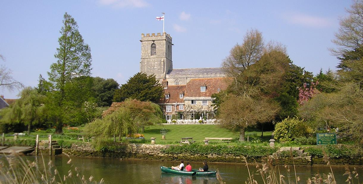 St Marys Church and The Priory Hotel from River Frome
