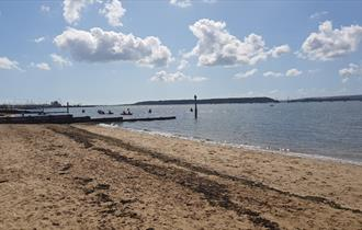 The park beach area on a sunny day that looks out into Poole harbour
