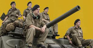 Soldiers sat on a tank
