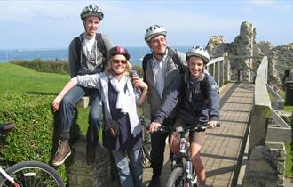 Family on bikes at Sandsfoot Casle, Weymouth