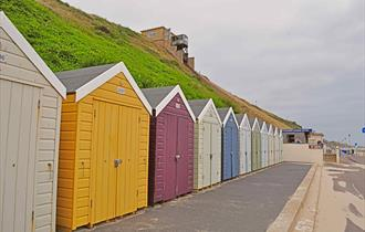 Row of colourful beach huts at southbourne