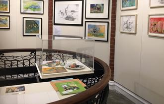 An image of Carolyn King's exhibition of drawings from her children books