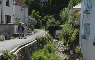 2 people walking at Lyme Regis, Dorset