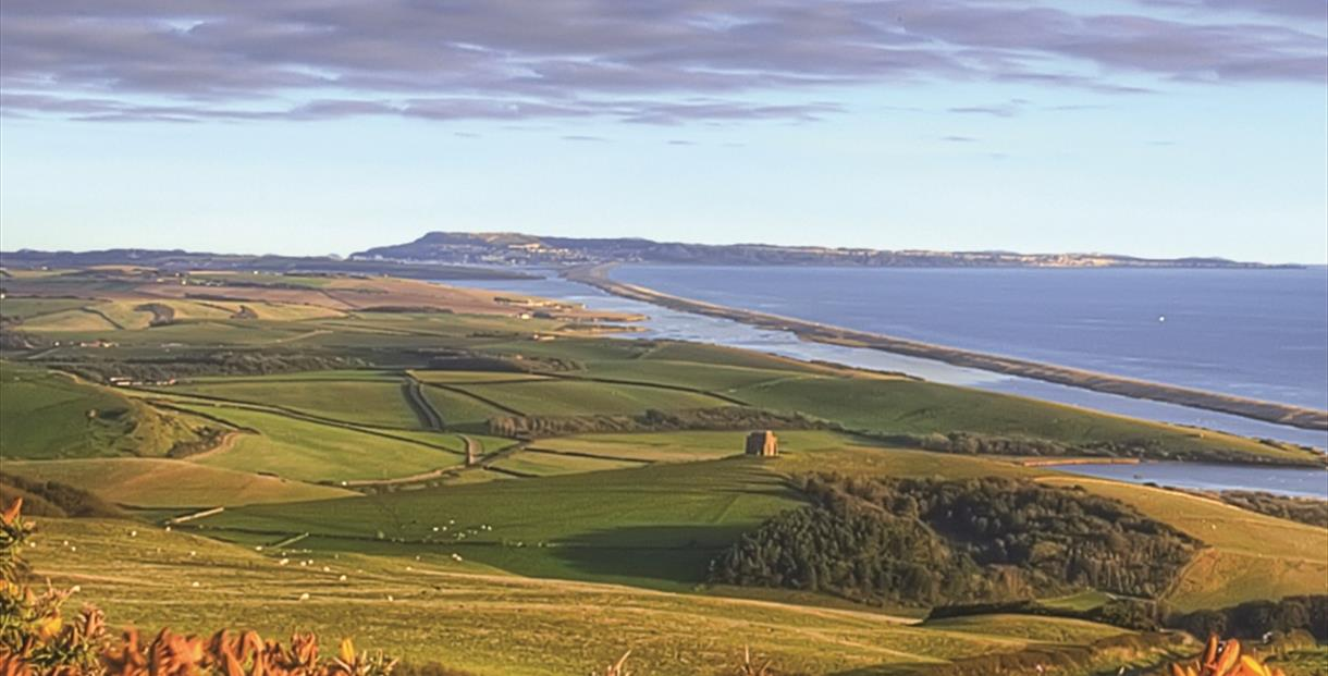 View from Abbotsbury of Chesil Beach and the Fleet lagoon - copyright Vertiworks