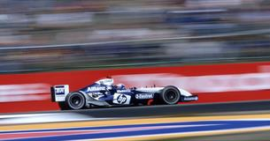 Williams F1 car racing with blurred background