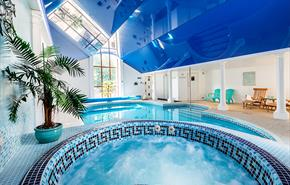 Indoor spa pools and relaxation areas at Berehayes Holiday Cottages