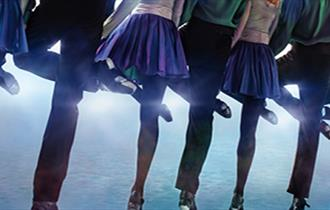 A row of dancers' legs.