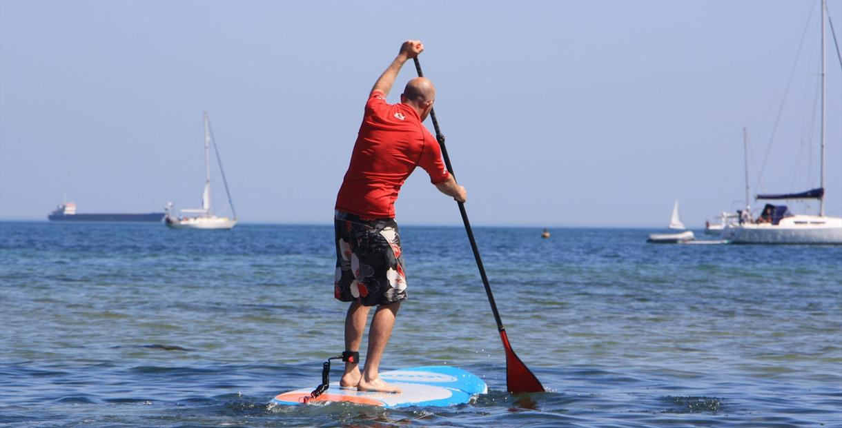 """learn to stand up paddleboard in studland"""