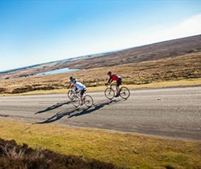 men taking on a challenging bike ride in the durham dales