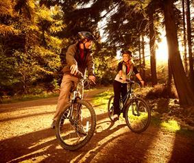 couple enjoying a bike ride in Hamsterley Forest