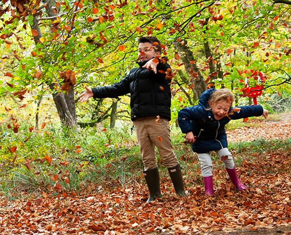 Kids playing with leaves in Durham October Half Term