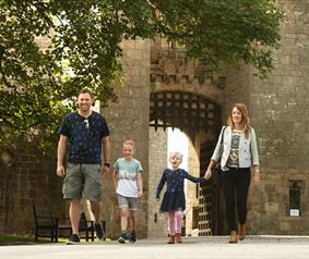 Raby Castle family walking out of gate