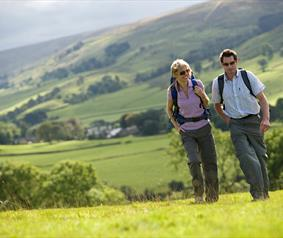 couple walking in the Durham Dales Countryside