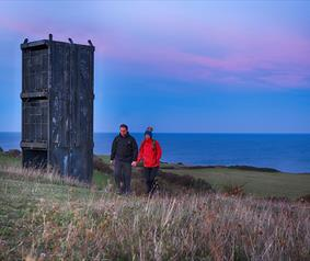 a couple walking on the Heritage Coast footpath at Easington.