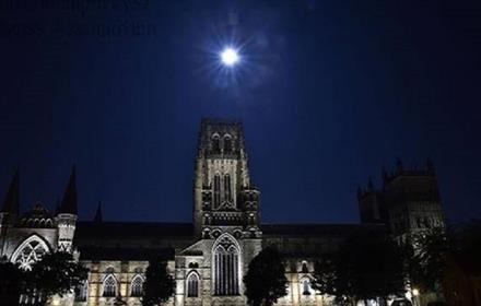 External view of Durham Cathedral under the full moon at night