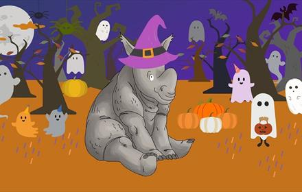 Cartoon image of Clara the Rhino wearing a purple witches hat.  Trees, ghosts, pumpkins, full moon.