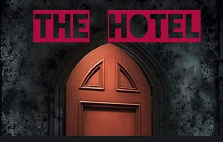 The Hotel, brown Gothic style door set in grey stone wall
